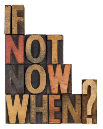 call for action or decision - a question in vintage letterpress wooden type, stained by ink, isolated on white photo