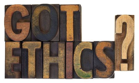 ethics and morals: Got ethics? Are you ethical question in vintage wooden letterpress type, stained by ink, isolated on white Stock Photo