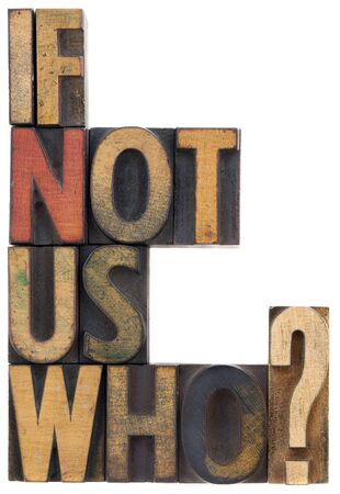 if not us, who - question or call for action, vintage wood lettepress type blocks, stained by ink, isolated on white Stock Photo