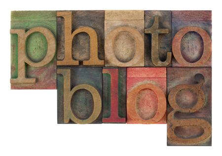 photoblog: word photoblog in old letterpress wooden type blocks, stained by colorful inks,  isolated on white