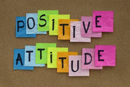 positive attitude: positive attitude concept - colorful sticky notes reminder on cork bulletin board