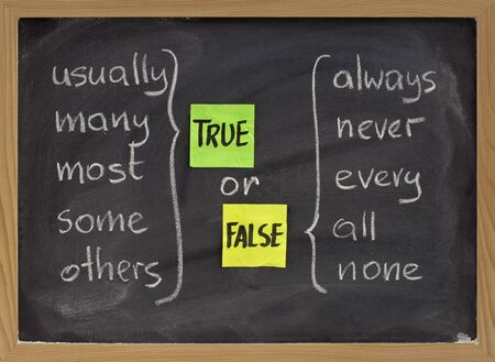 true or false concept, words commonly associated with truth (usually, many, most, some, others) and false (always, never, every, all, none) - color sticky notes and white chalk handwriting on blackboard Stock Photo - 6983882