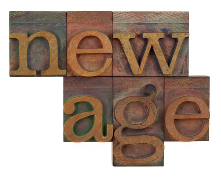new age: new age in vintage wood letterpress type, stained by color ink, isolated on white Stock Photo