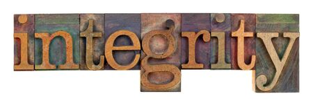 morale: the word of integrity in vintage wood letterpress type, stained by color inks, isolated on white Stock Photo