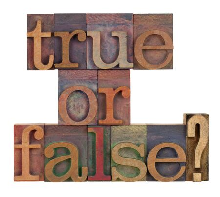 letterpress blocks: True or false question in vintage letterpress type blocks stained by color inks , isolated on white Stock Photo