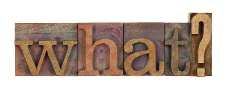 What question in vintage wood letterpress type blocks, stained by color ink, isolated on white photo