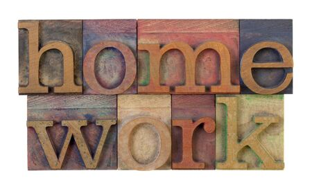 the word homeowork in vintage wooden letterpress type blocks, stained by color ink, isolated on white