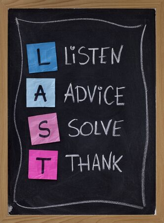 LAST (listen, advice, solve, thank) - acronym for training customer service and complaints handling. blackboard with sticky notes and white chalk handwriting Stock Photo - 7224374