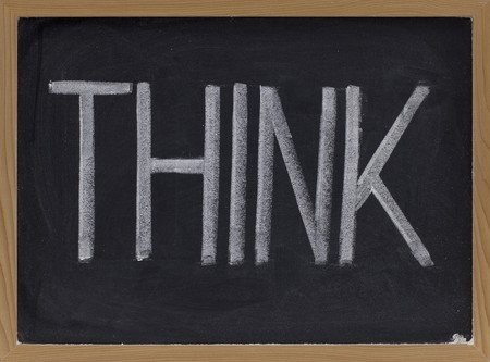 the word think - big letters in white chalk on blackboard