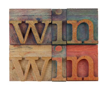 win win strategy or conflict resolution concept - vintage wooden letterpress type blocks, stained by color ink, isolated on white, square composition Stock Photo