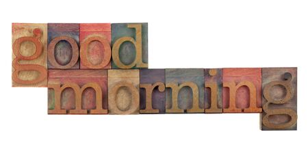 good morning greeting in vintage wood letterpress type blocks, stained by color ink, isolated on white Stock Photo - 7224440