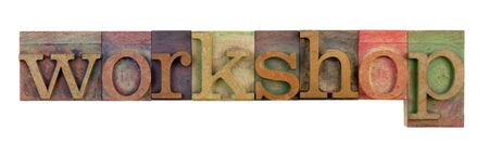 the word workshop in vintage wood letterpress type blocks, stained by color ink, isolated on white Stock Photo - 7224439