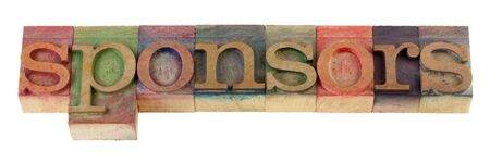 sponsors: the sponsors word in vintage wooden letterpress type blocks, stained by color ink, isolated on white