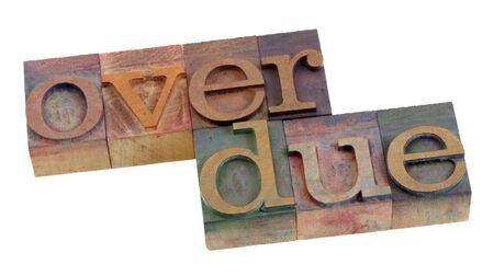 overdue: overdue word in vintage wooden letterpress printing blocks, stained by color ink, isolated on white