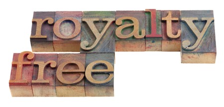 royalty free words in vintage wooden letterpress printing blocks, stained by color ink, isolated on white Stock Photo - 7432020