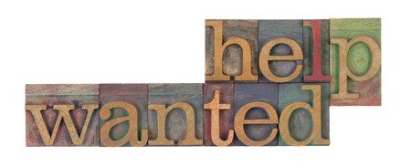 help: help wanted words in vintage wooden letterpress printing blocks, stained by color inks, isolated on white