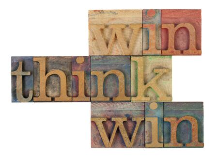think win win words in vintage wooden letterpress printing blocks, stained by color inks, isolated on white