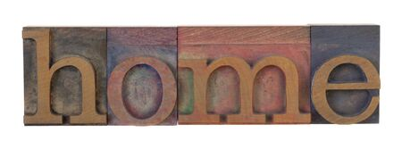 home - word in vintage letterpress printing blocks, stained by color inks, isolated on white Stock Photo - 7508404