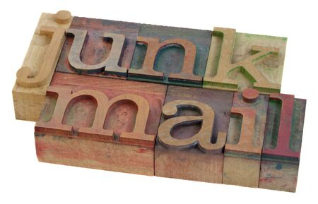 junk mail - words in vintage letterpress printing blocks, stained by color inks, isolated on white photo