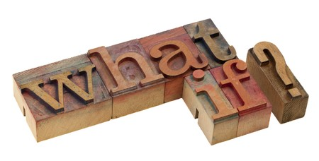 what if question - words in vintage letterpress printing blocks, stained by color inks, isolated on white Stock Photo