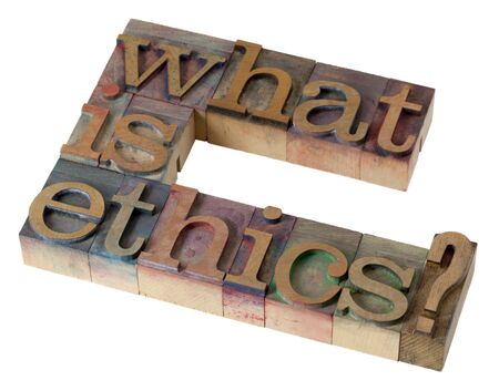 what is ethics - question in vintage letterpress printing blocks, stained by color inks, isolated on white