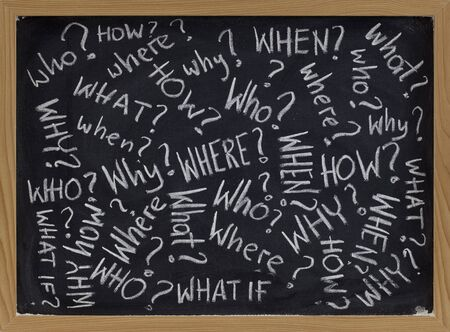 who, what, why, how, where, when, what if questions - white chalk handwriting on blackboard