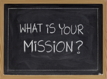 what is your mission question - white chalk handwriting on blackboard Banco de Imagens - 7543895