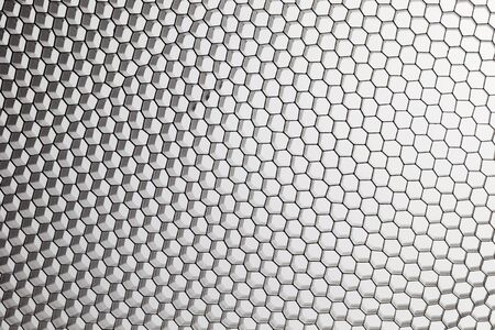 black, metal honeycomb grid on white abstract background Imagens - 7590761