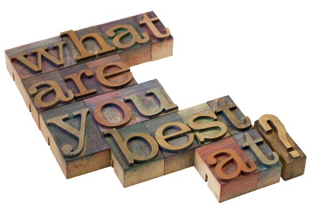 what are you best at question in vintage wooden letterpress printing blocks, stained by color inks Stock Photo