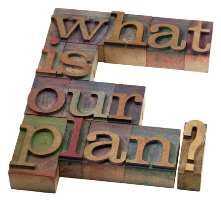 planning concept - what is our plan question in vintage wooden letterpress printing blocks, stained by color inks Stock Photo - 7590756