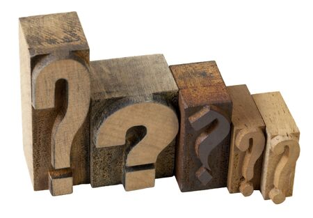 dilemma concept - 5 questions marks in vintage wooden letterpress printing blocks, isolated on white Stock Photo - 7590759