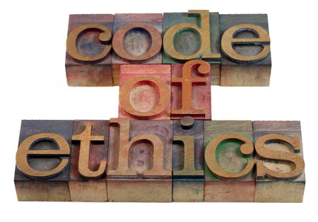 ethics: code of ethics words or headline - vintage wooden letterpress printing blocks stained by color inks Stock Photo