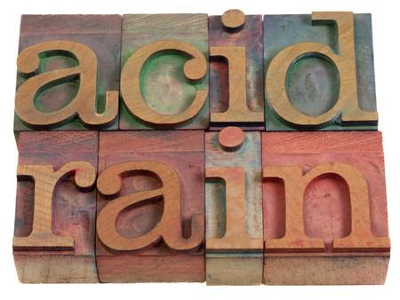 lluvia acida: lluvia �cida (contaminaci�n atmosf�rica) - palabras en bloques de impresi�n de tipograf�a de madera vintage  Foto de archivo