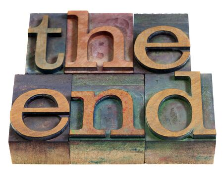 The end concept - words in vintage wooden letterpress printing blocks, stained by color inks, isolated on white Stock Photo - 7765832