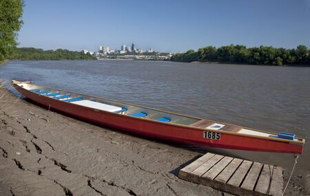KANSAS CITY, KS - AUGUST 23: 20 person, Guinness record winning, dragon boat at muddy shore, day before  the start of 5th Missouri River 340 Race, August 23, 2010, at Kaw Point (confluence of Missouri and Kansas Rivers). Stock Photo - 7738401