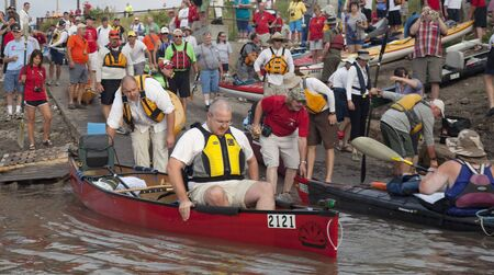 KANSAS CITY, KS - AUGUST 24: Kayak and canoes are launching at the start of 5th Missouri River 340 Race, August 24, 2010, at Kaw Point (confluence of Missouri and Kansas Rivers) Stock Photo - 7738403
