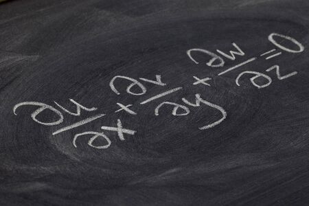 continuity equation (mathematical physics) - white chalk handwriting on blackboard Stock Photo - 7765881