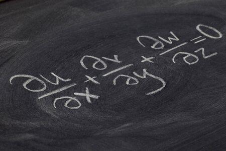 continuity equation (mathematical physics) - white chalk handwriting on blackboard Stock Photo - 7765881