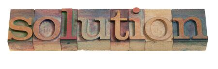 solution - word in vintage wood letterpress printing blocks, isolated on white Imagens