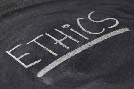 ethics word - white chalk hadwriting on blackboard photo