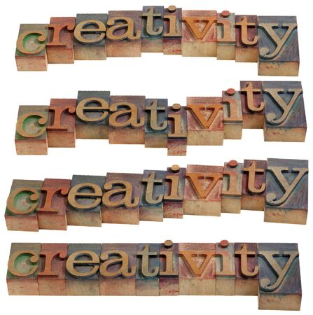 creativity - word in vintage wooden letterpress printing blocks, isolated on white, four layouts