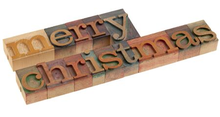 Merry Christmas greetings in vintage wooden letterpress printing blocks, isolated on white Stock Photo - 7765918