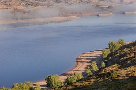 horsetooth rock: foggy morning on Horsetooth Reservoir near Fort Collins, Colorado. early fall Stock Photo