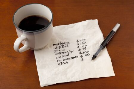 working on household budget - napkin concept with coffee cup on wooden table Stock Photo - 7912031