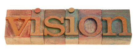 envision: vision - word in vintage wooden letterpress printing blocks isolated on white Stock Photo