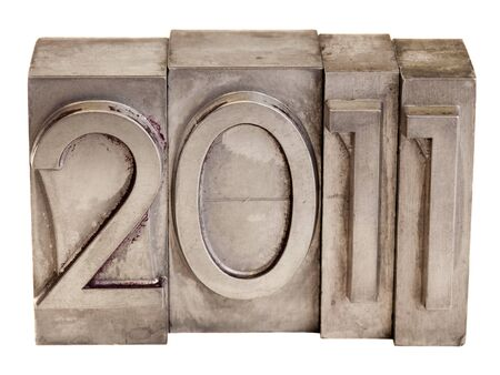 New Year of 2011 - numbers in vintage scratched metal letterpress printing blocks, isolated on white Stock Photo - 7912043