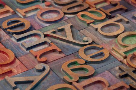 woodtype: abstract of vintage wooden letterpress printing blocks stained by color inks Stock Photo