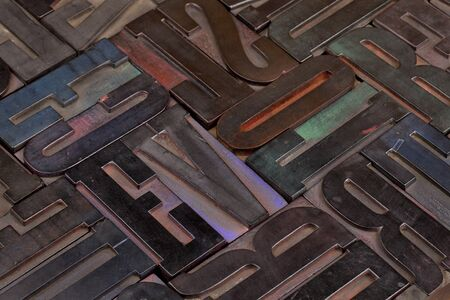 woodtype: bacground of antique wooden letterpress printing blocks stained by color inks