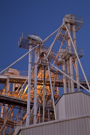 industrial abstract - top of a grain elevator with gravity flow pipes at night Stock Photo - 8031151