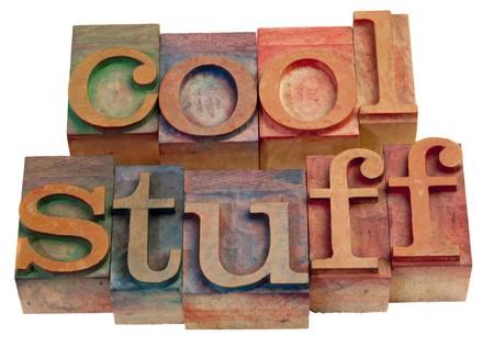 coisa: cool stuff - words in vintage, wooden letterpress printing blocks isolated on white Banco de Imagens